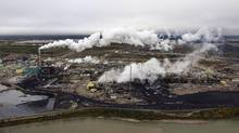 Oil and gas production, such as the work done at this Suncor processing plant in For McMurray, Alta., was the country's fastest-growing source of emissions between 2005 and 2013.