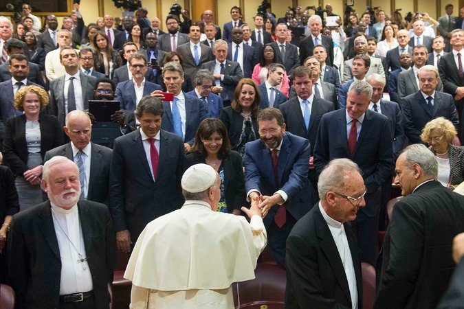 Pope Francis greeted Mayor Ignazio Marino of Rome at the Vatican. Mayor Bill de Blasio of New York was next to Mr. Marino.