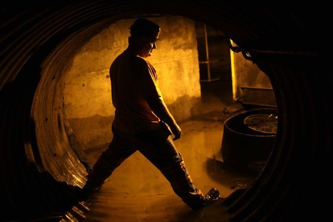 A miner at a coal processing facility near Gilbert, W.Va. This year the number of coal miners in the United States dropped more than 10 percent, to just over 80,000 workers. Credit Robert Galbraith/Reuters